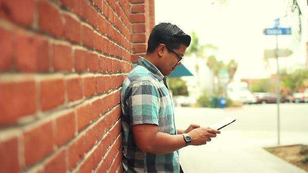 Hipster Man Using Tablet Computer Against Brick Wall Royalty-free stock video