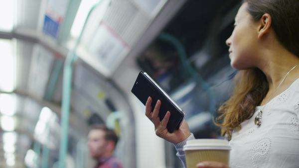 Attractive woman on a train reading her phone Royalty-free stock video