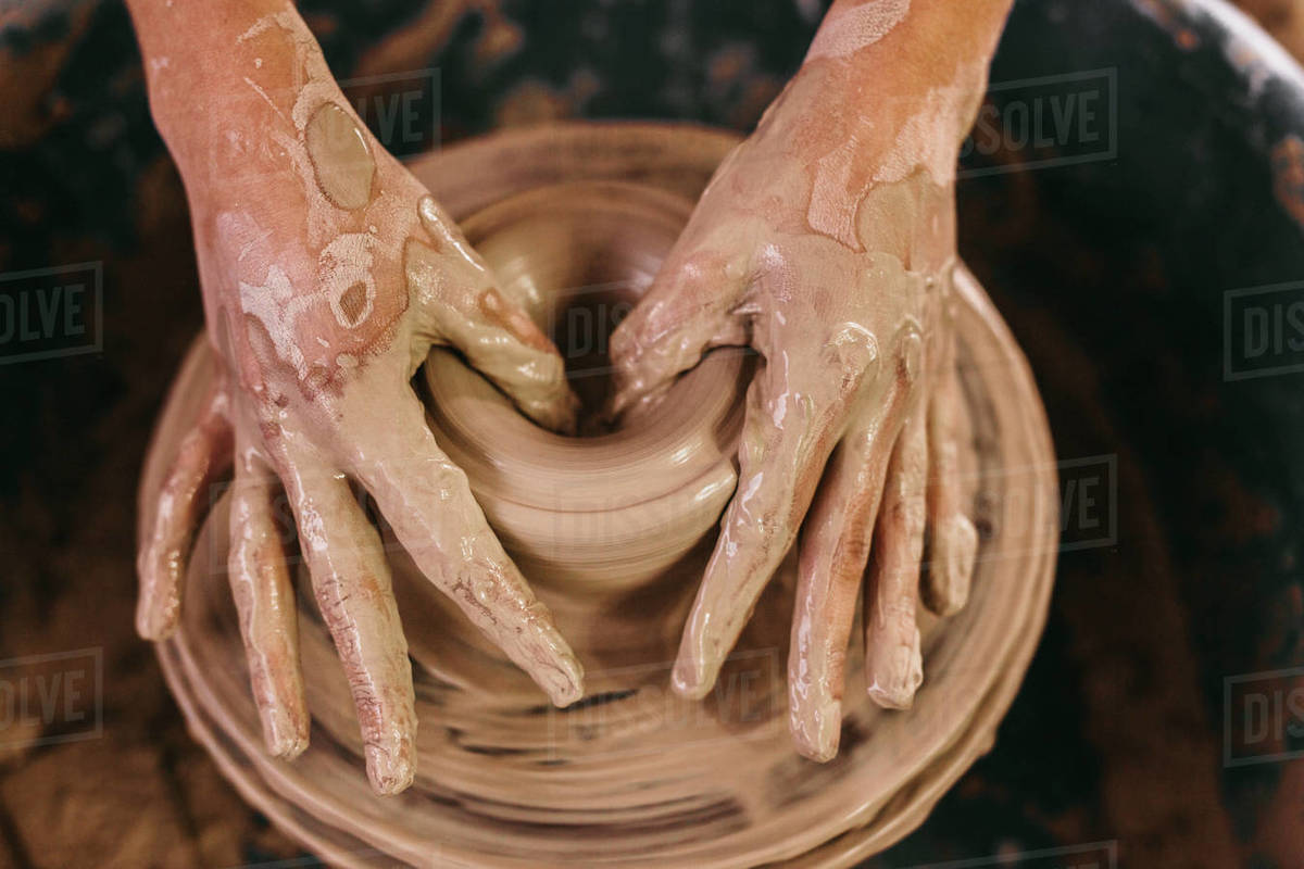Potter Making A Clay Pot On Pottery Wheel In Workshop Close Up Of