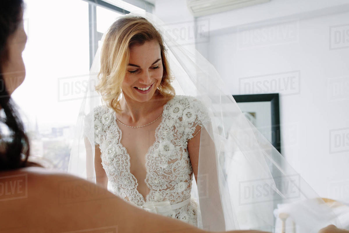 Beautiful Young Woman Trying On Wedding Dress In Bridal Shop D2012 208 035