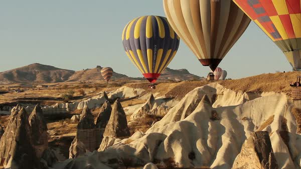 Colorful hot air balloons flying over valleys in Goreme, Cappadocia, Turkey. Royalty-free stock video