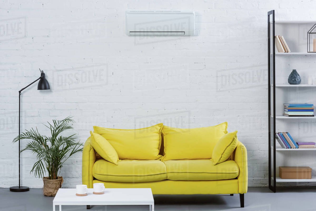 interior of modern living room with yellow couch and air D2115_123_629