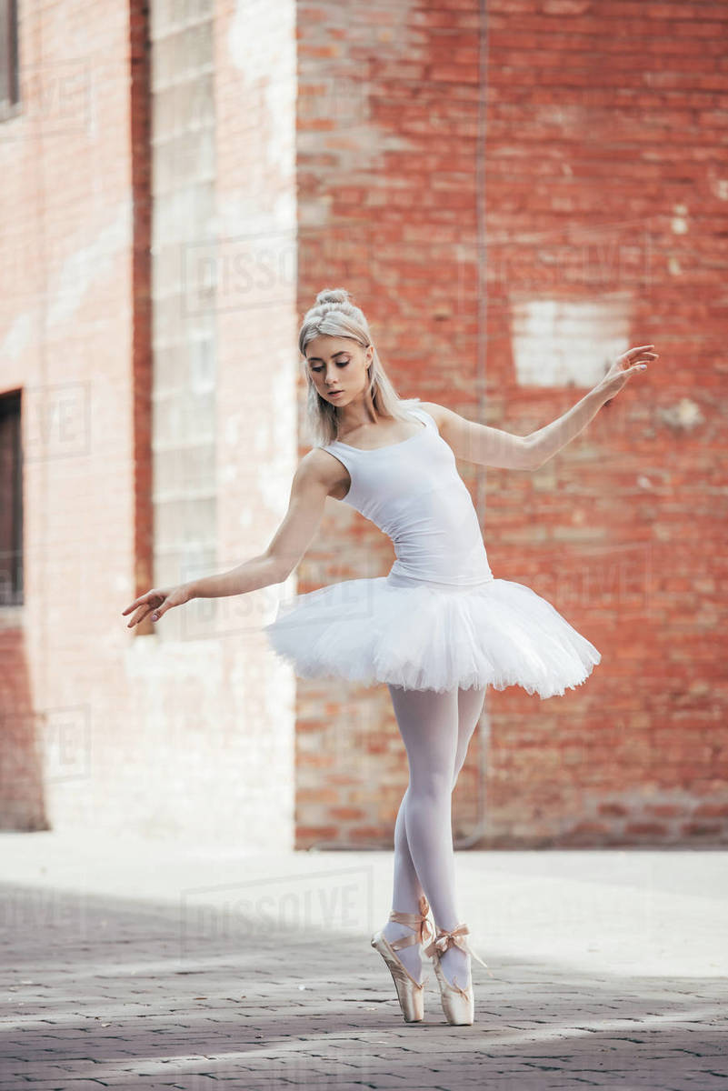 white tutu and pointe shoes dancing