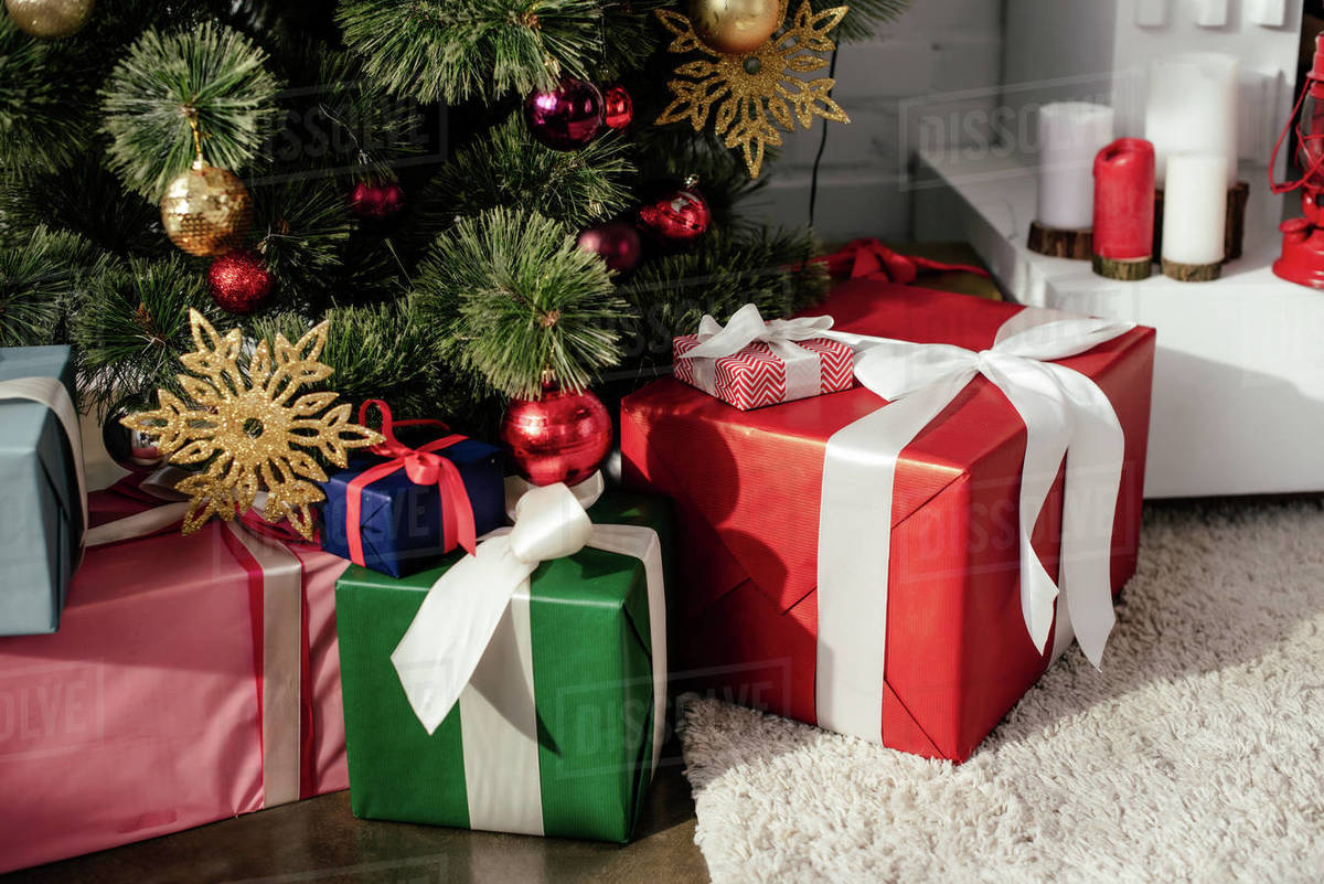 Gift Boxes Under Christmas Tree With Baubles In Room Stock Photo Dissolve