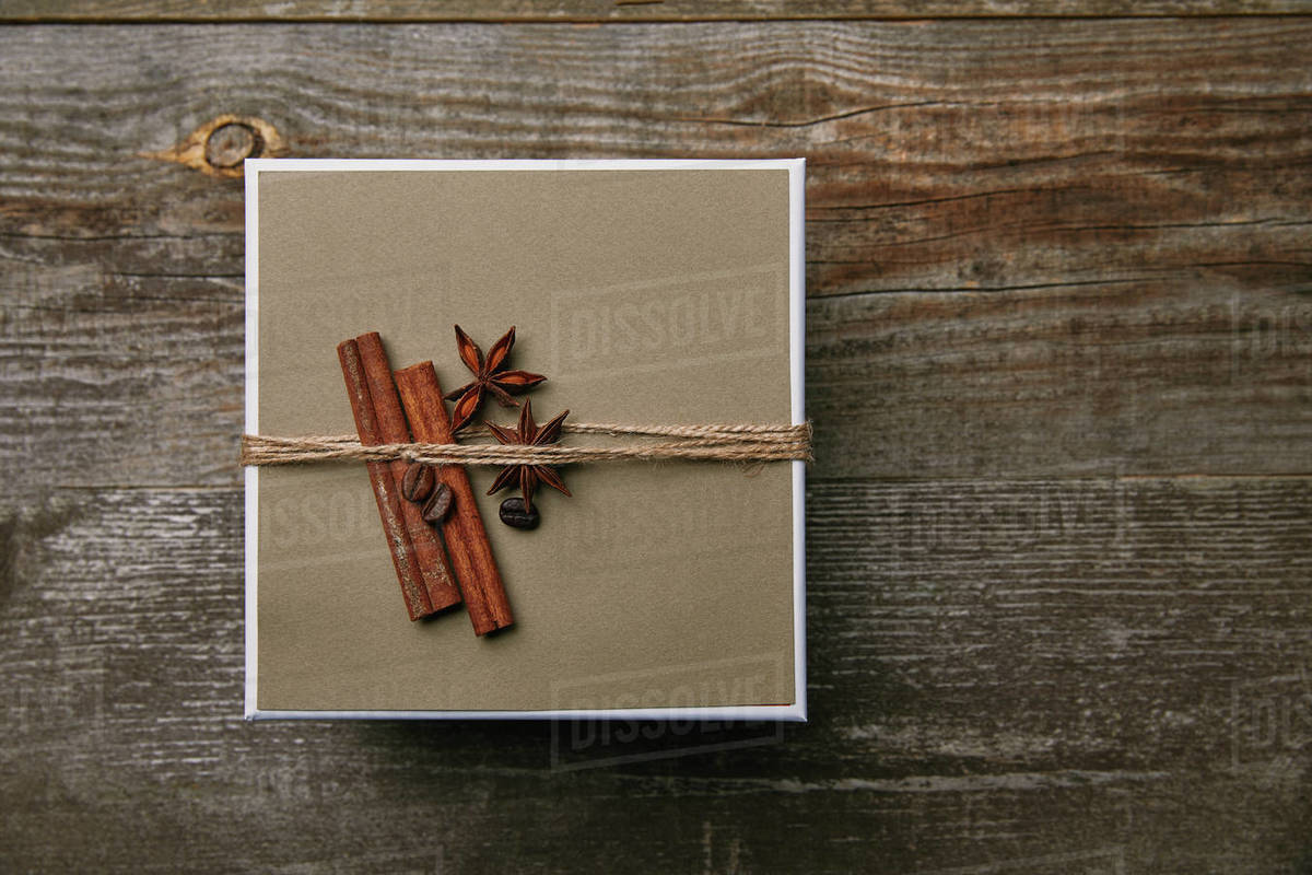 Top View Of Box Decorated With Spices On Rustic Wooden Table Stock Photo