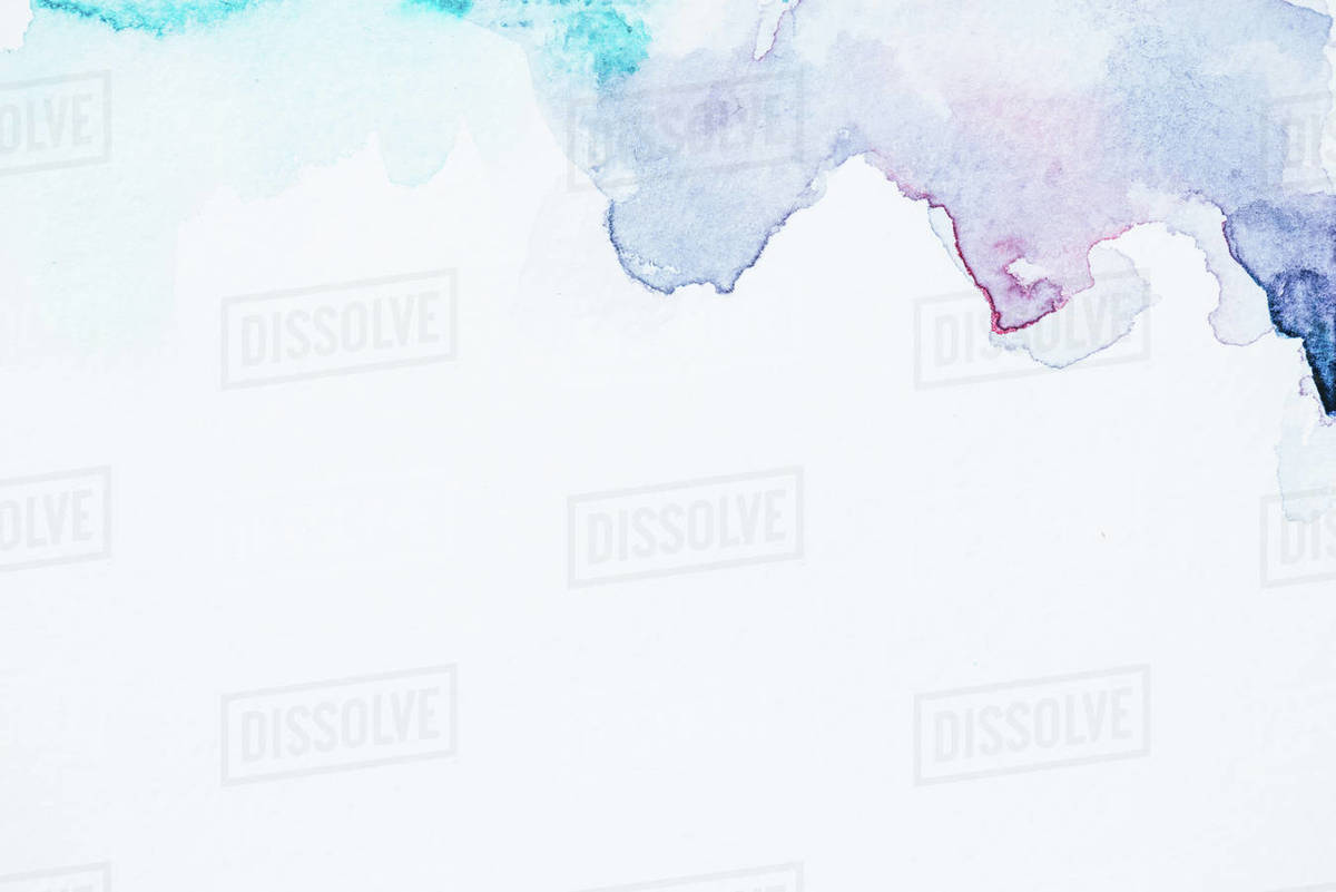 Abstract Blue And Purple Watercolor Blots On White Paper Background With Copy Space Stock Photo