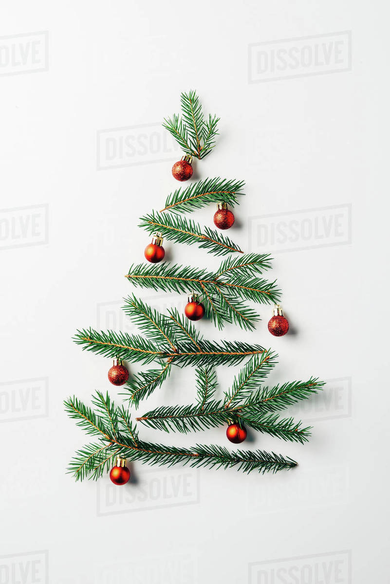 Christmas Tree White Background.Top View Of Pine Branches Arranged In Christmas Tree With Toys On White Background Stock Photo