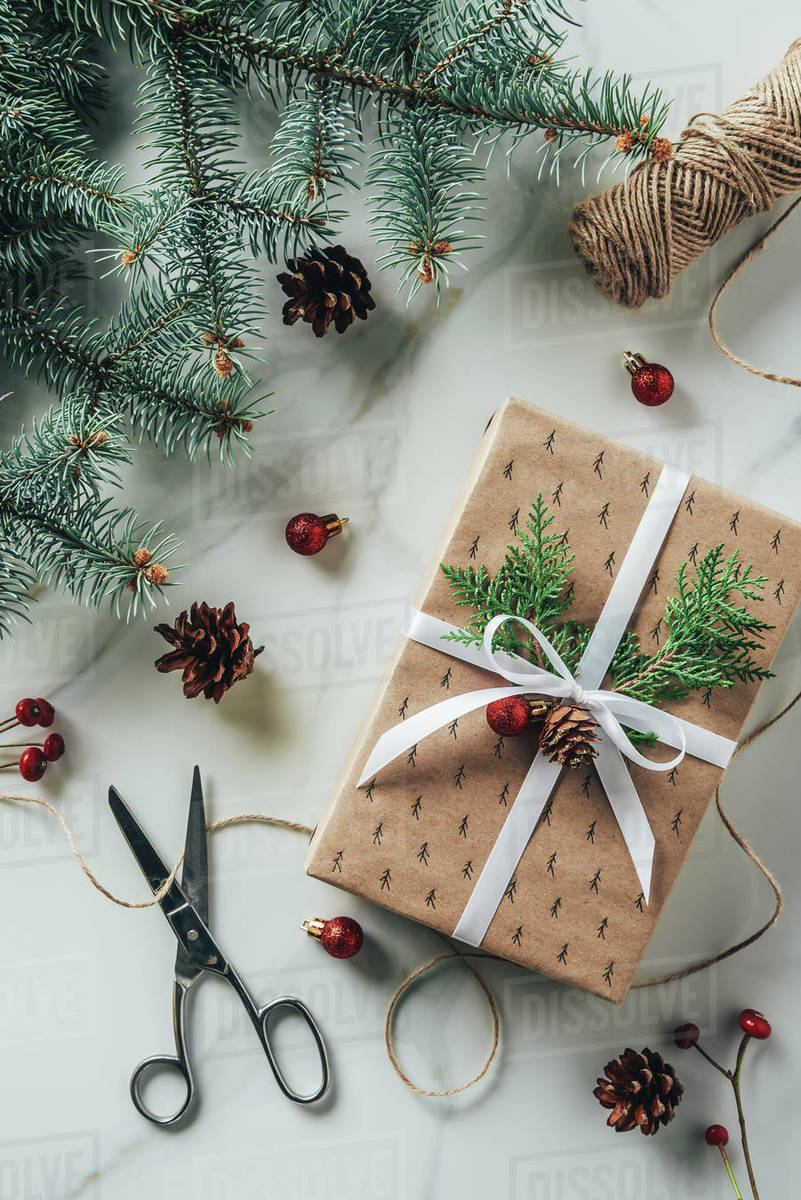 Christmas Top View.Top View Of Christmas Gift Box With Fir Branches And Scissors On Marble Table Stock Photo