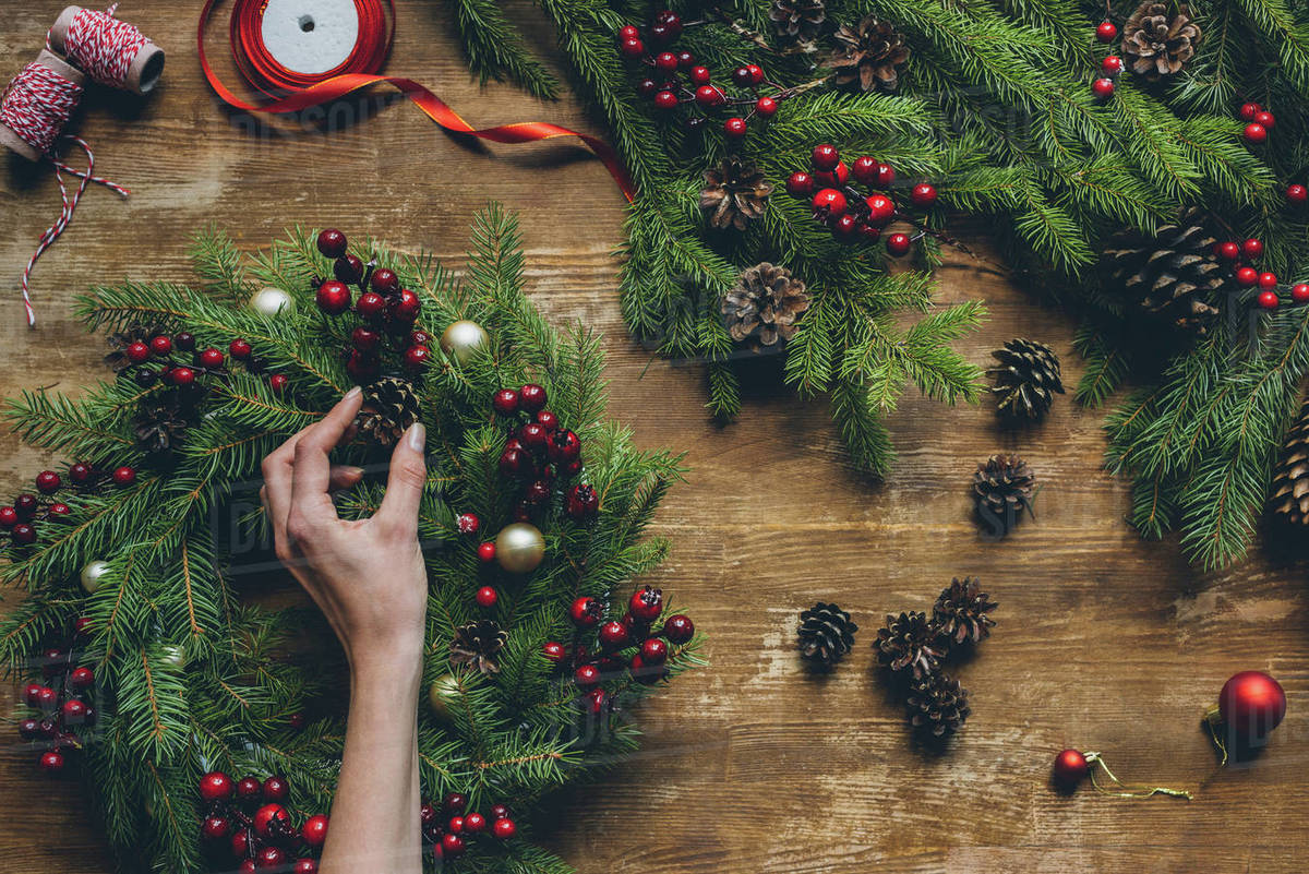 Christmas Top View.Top View Of Florist Hand Making Christmas Wreath On Wooden Tabletop Stock Photo