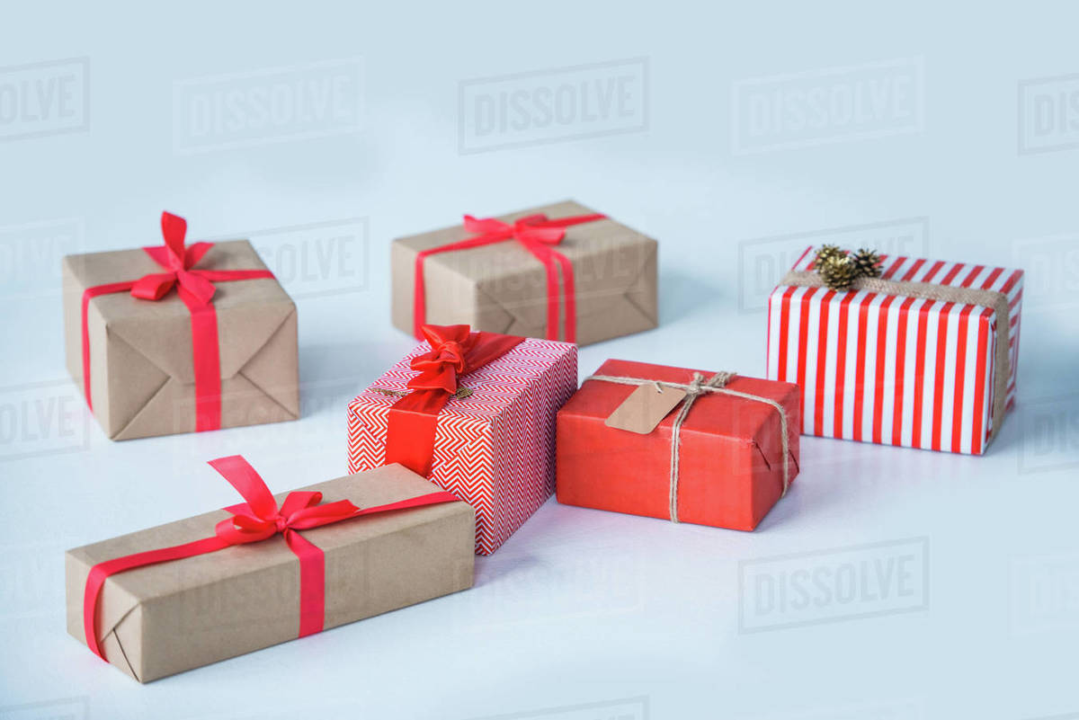 Christmas Presents.Close Up View Of Wrapped Christmas Presents Isolated On Grey Stock Photo
