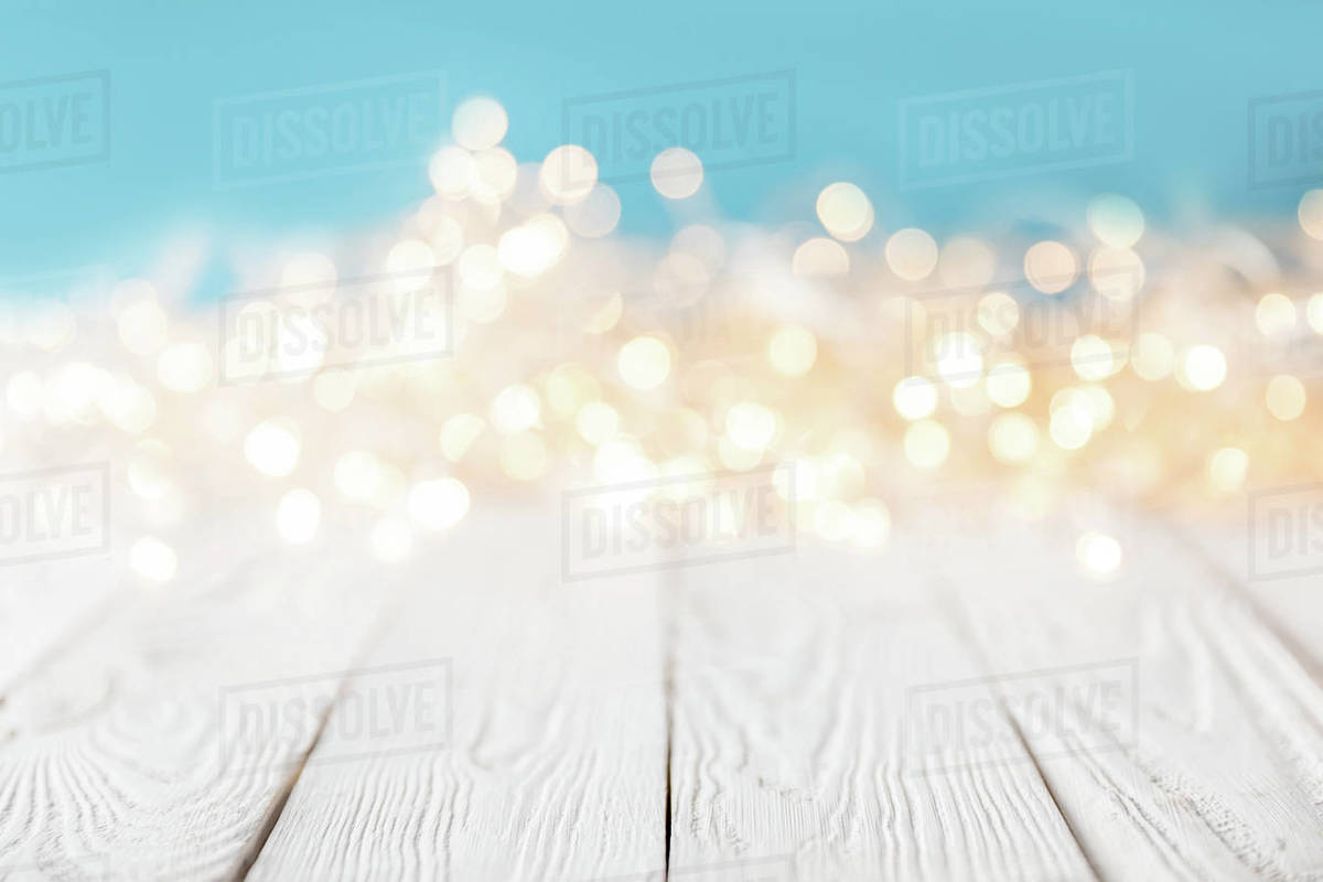 Christmas Texture.Bright Blurred Lights On White Wooden Surface Christmas Texture Stock Photo