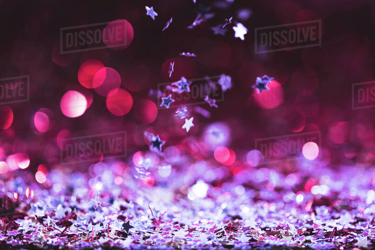 Christmas Texture.Christmas Texture With Falling Pink And Silver Shiny Confetti Stars Stock Photo
