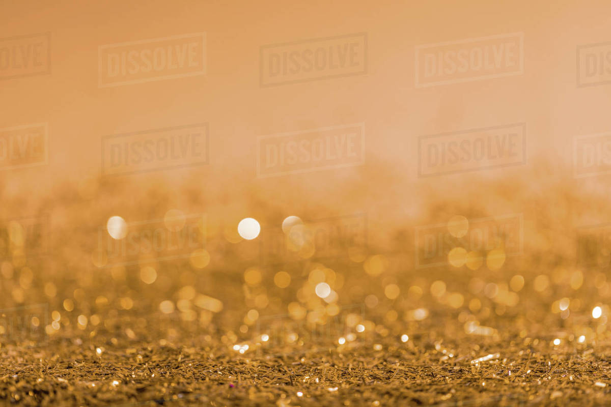 Christmas Background Images Gold.Christmas Background With Golden Shiny Blurred Confetti Stock Photo