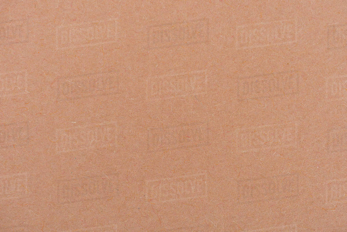 Texture of light brown color paper as background stock photo