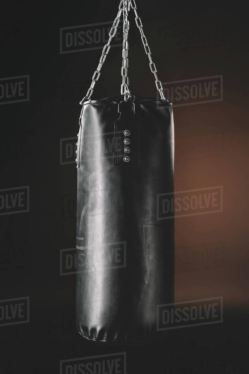 Punching Bag Hanging In Darkness