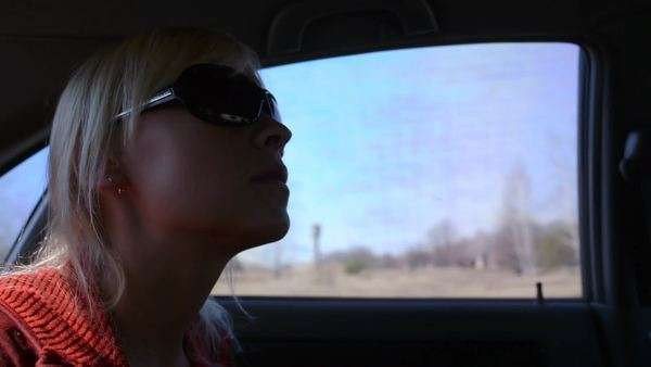 Close-up shot of woman traveling in car Rights-managed stock video