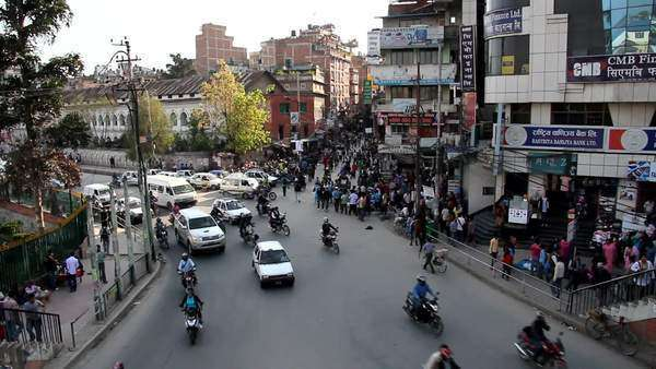 Wide shot of a busy street showing traffic and people Royalty-free stock video