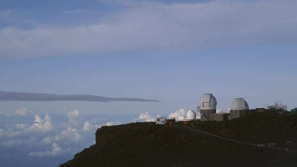 Wide shot of observatory buildings on a Hawaiian coast Royalty-free stock video
