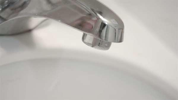 Tap bathroom sink dripping water waste Fresh clean flowing water ...