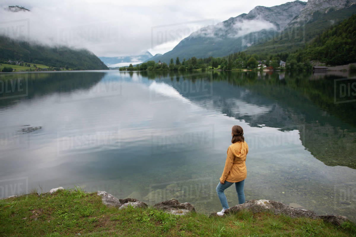 Woman standing at lake shore and enjoying the view Royalty-free stock photo