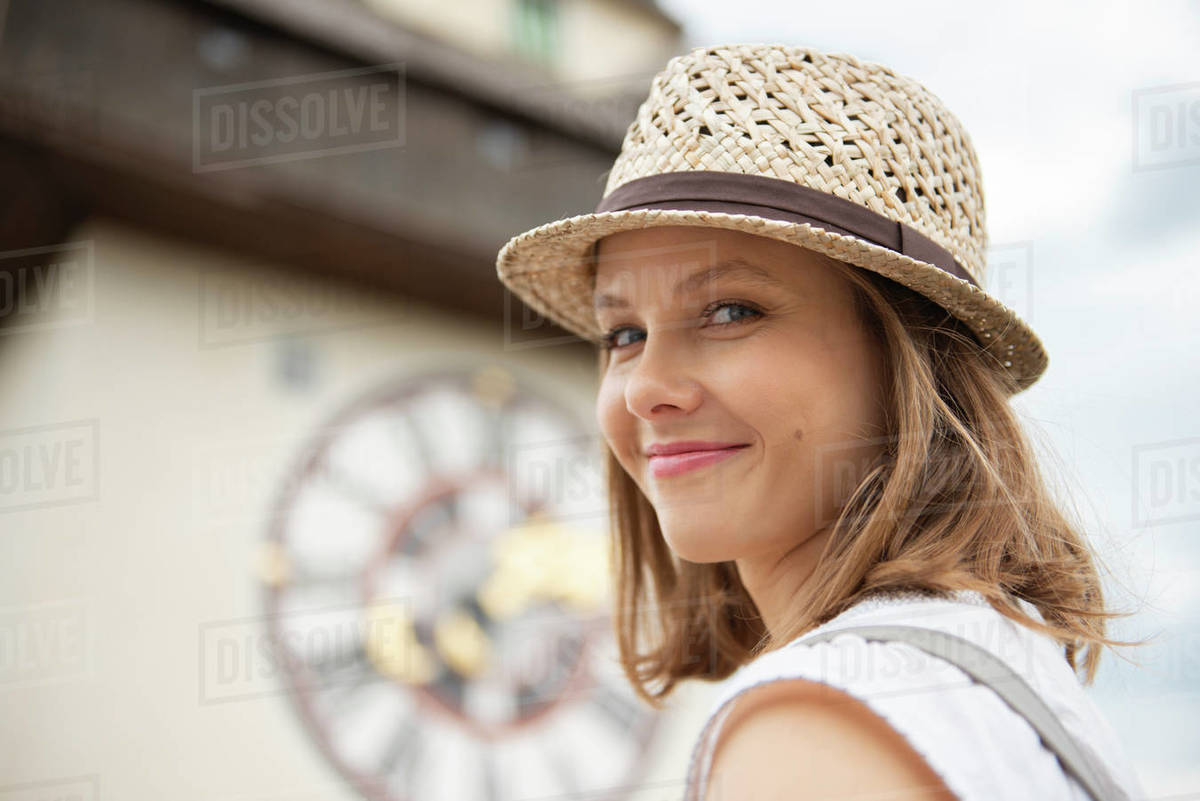 Travelling woman standing at medieval Clock tower Uhrturm in city Graz, Austria Royalty-free stock photo