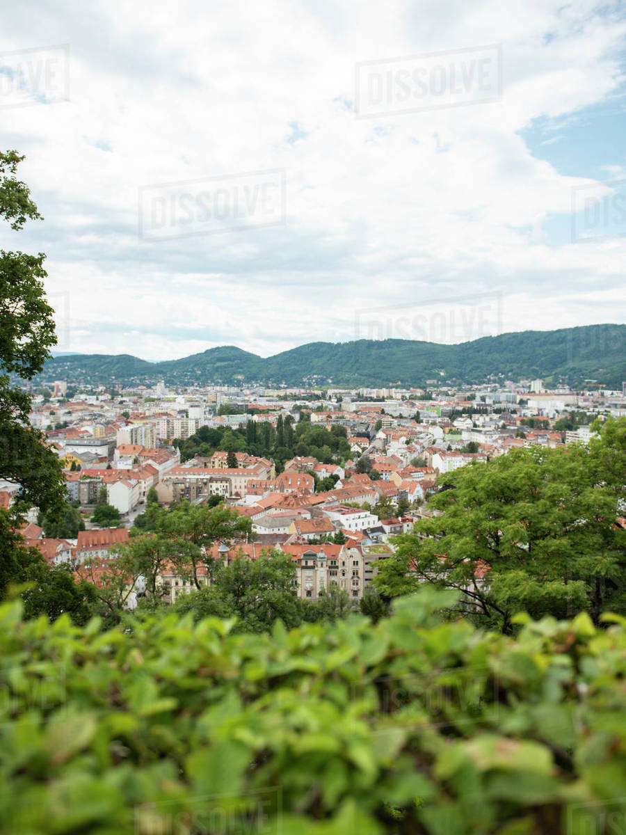 View of the city Graz from above through lush foliage Royalty-free stock photo