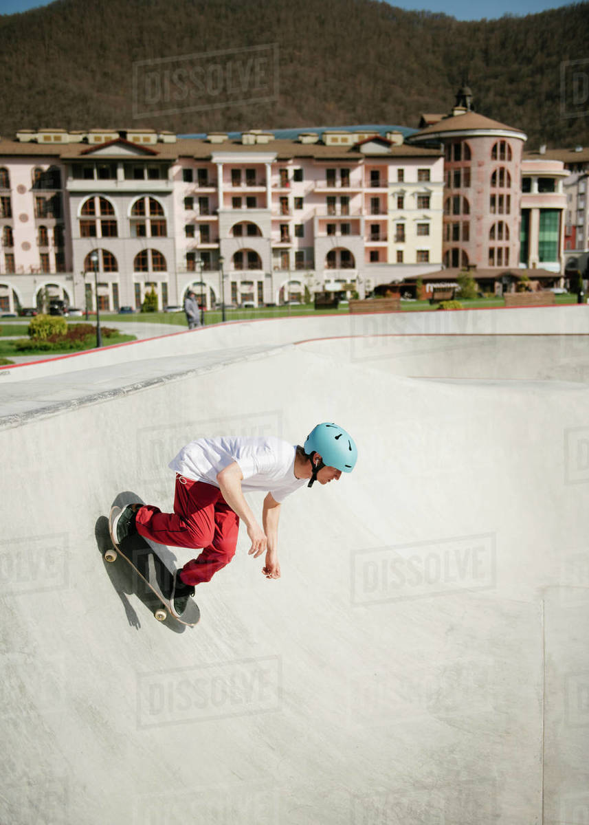 Young man doing skateboarding trick outdoor Royalty-free stock photo