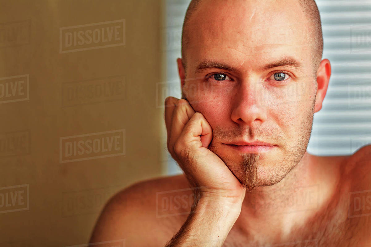 Portrait of man resting his head in his hand Royalty-free stock photo