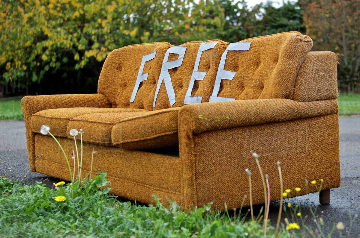 Old abandoned sofa with the word free - Stock Photo - Dissolve