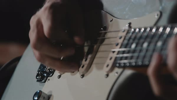 Close-up shot of man playing the guitar Royalty-free stock video