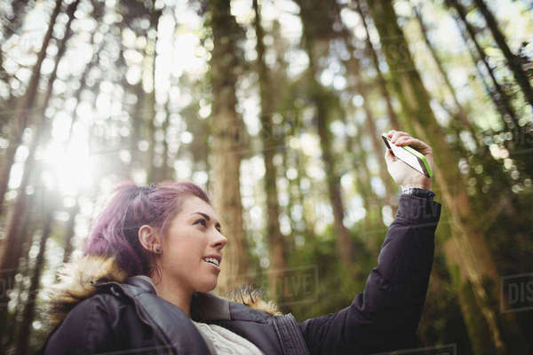 Woman taking a selfie in the wood  Royalty-free stock photo