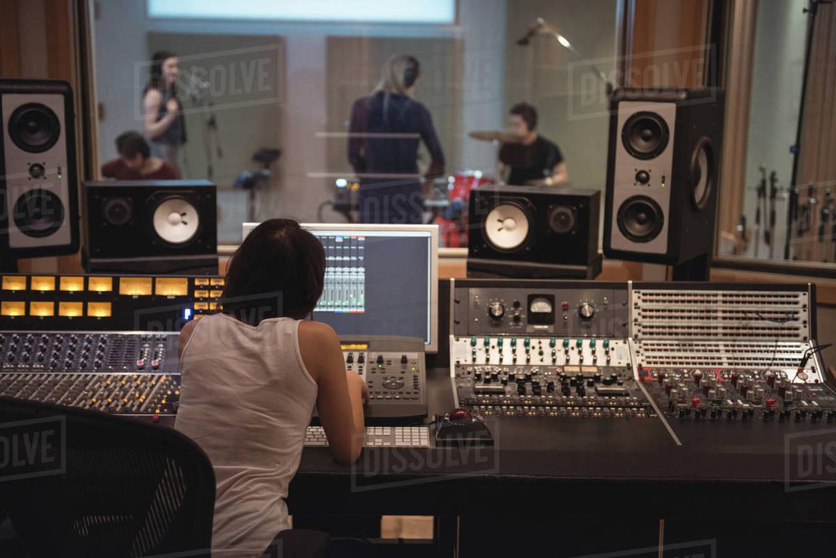 audio engineer using sound mixer in recording studio stock photo dissolve. Black Bedroom Furniture Sets. Home Design Ideas