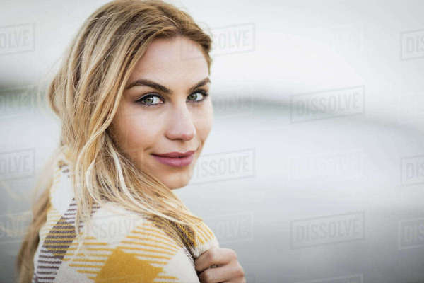 Beautiful blonde woman relaxing in the coastline Royalty-free stock photo