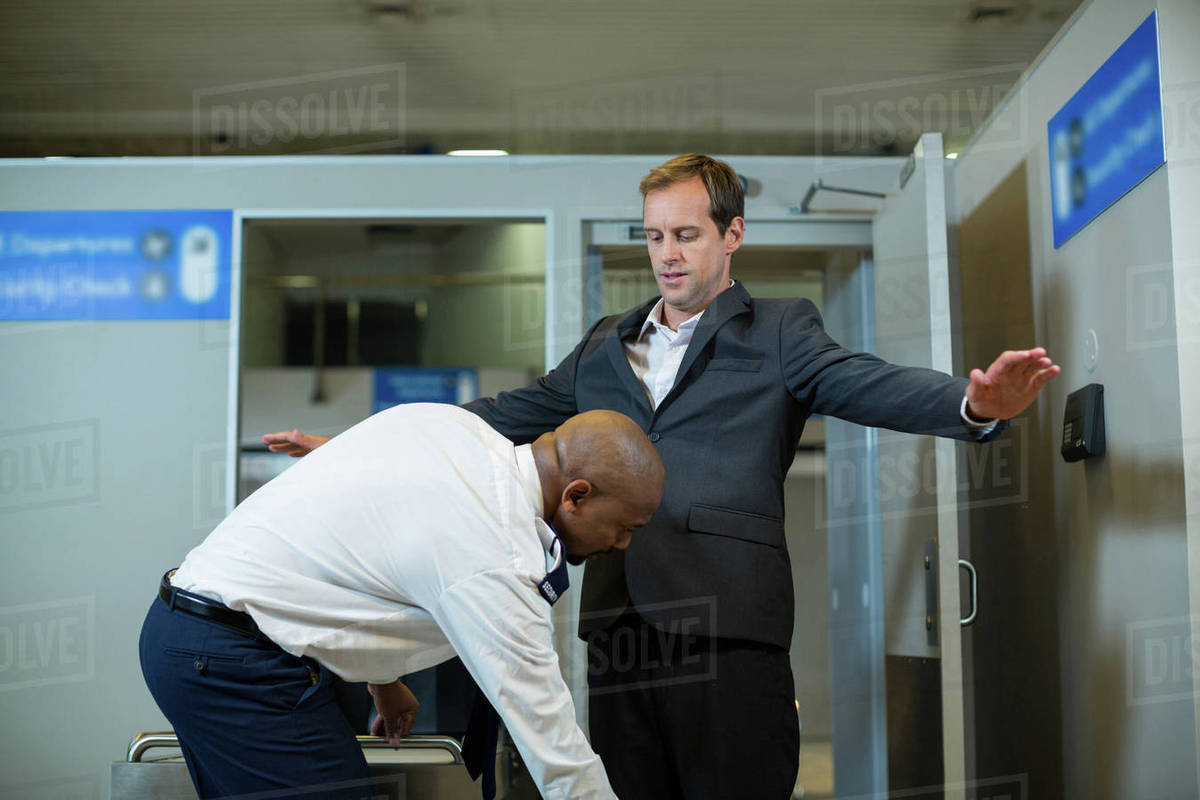 Jew Detector: Airport Security Officer Using A Hand Held Metal Detector