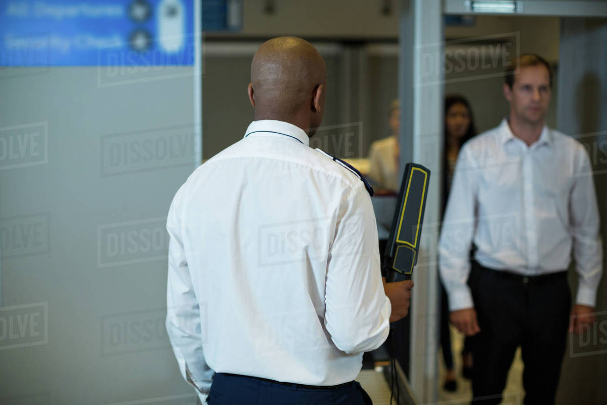 Jew Detector: Airport Security Officer Standing With Metal Detector To