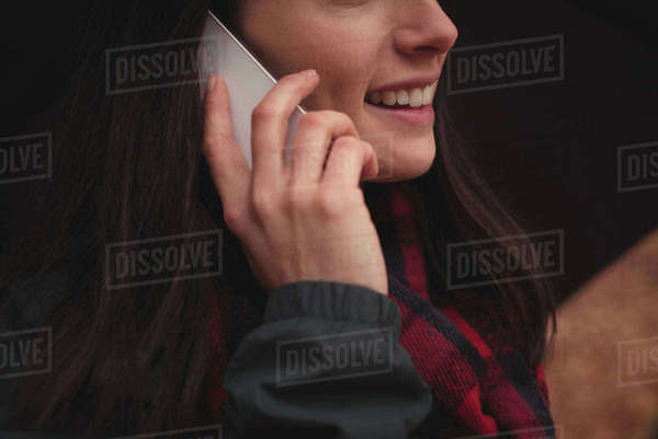 Mid section of woman talking on mobile phone Royalty-free stock photo