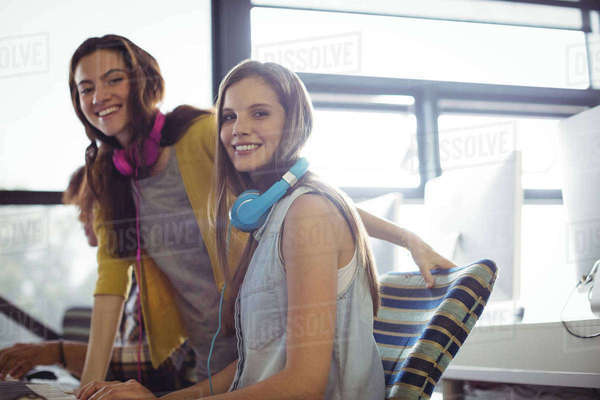 Portrait of female sound engineer and colleagues working in office Royalty-free stock photo