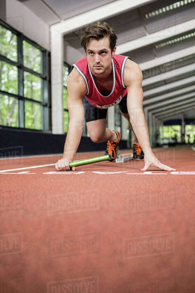 Athlete ready to run in gym Royalty-free stock photo