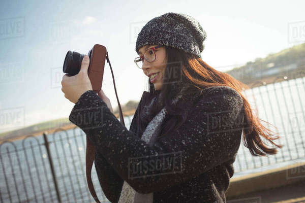 Smiling woman taking photos on digital camera Royalty-free stock photo