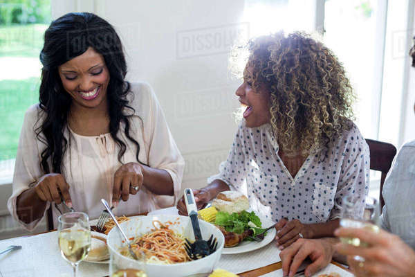 Friends talking while having meal at home Royalty-free stock photo