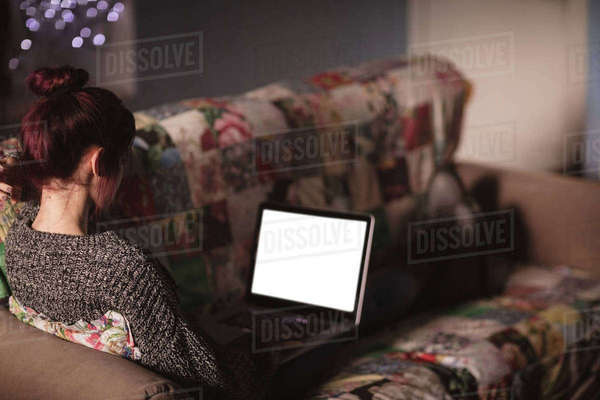 Young woman using laptop in living room at home Royalty-free stock photo