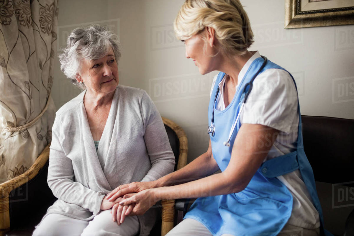 Nurse Taking Care Of A Senior Woman In A Retirement Home Stock Photo Dissolve