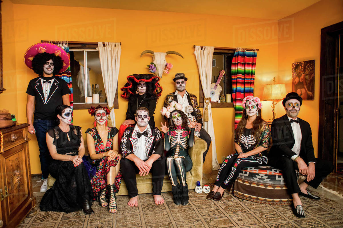 Group of friends in Dia de los Muertos makeup and costume, Day of the Dead celebration in the desert, California, United States of America, North America Royalty-free stock photo