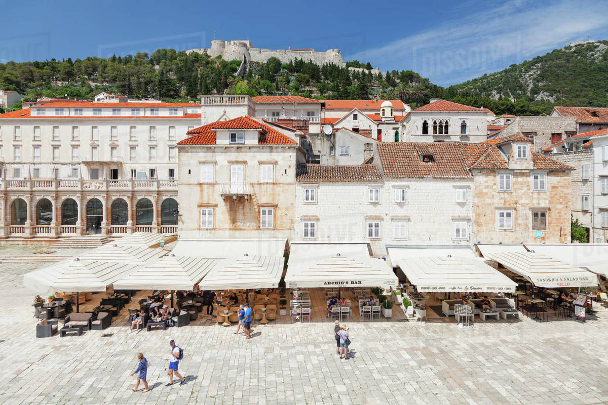 Restaurants at the Main Square, view to Spanisch Fortress, Hvar, Hvar Island, Dalmatia, Croatia, Europe Royalty-free stock photo