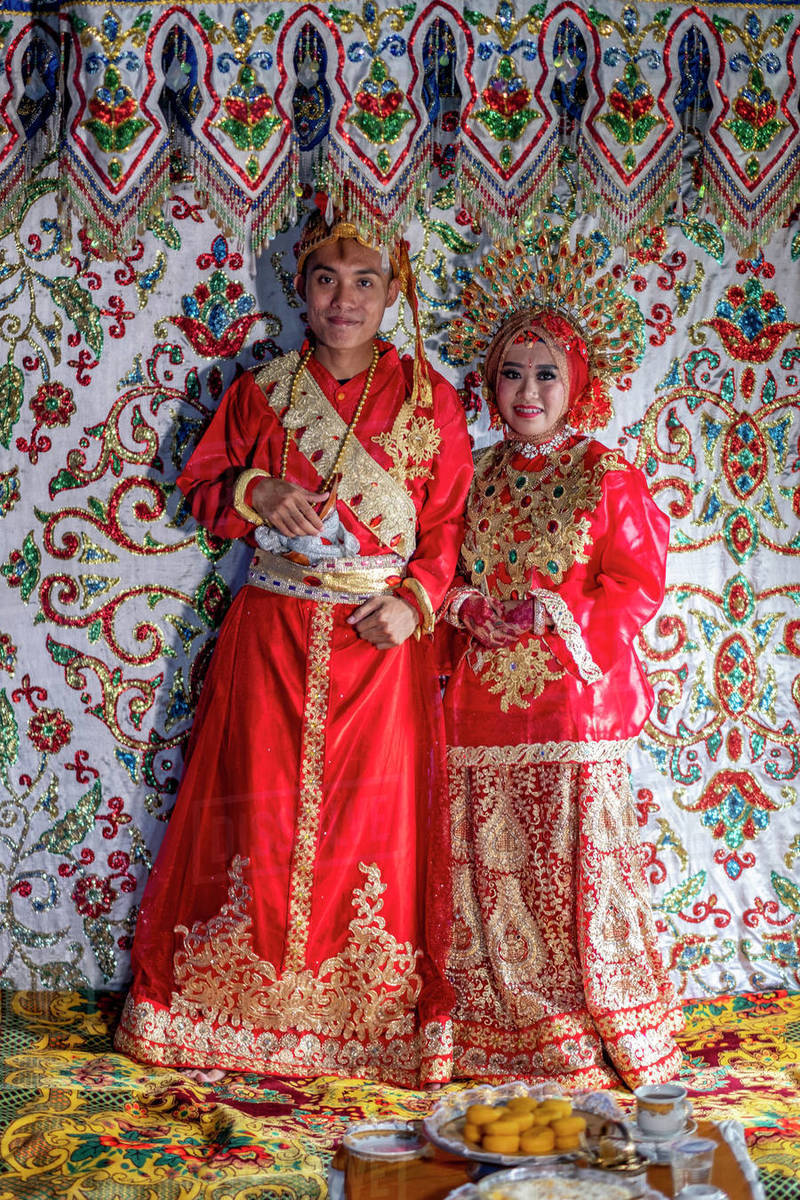 A bride and groom at a traditional Sulawesi wedding, Makassar, Sulawesi, Indonesia, Southeast Asia, Asia Royalty-free stock photo