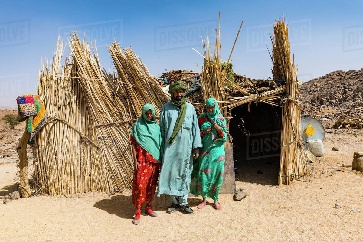 Tuareg family posing in front of their hut, near Tamanrasset, Algeria, North Africa, Africa Royalty-free stock photo