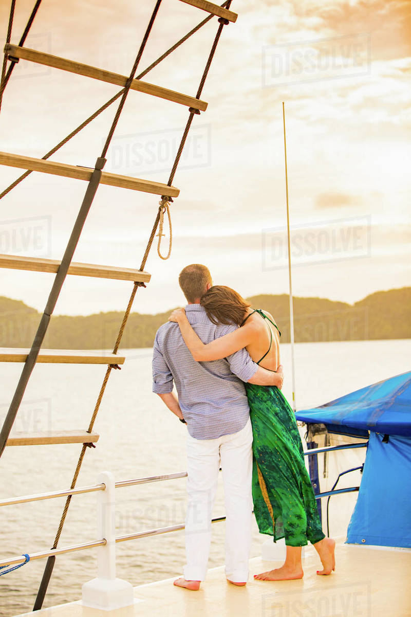 Couple enjoying the sunset on the Palau Siren, Koror Island, Palau, Micronesia, Pacific Royalty-free stock photo