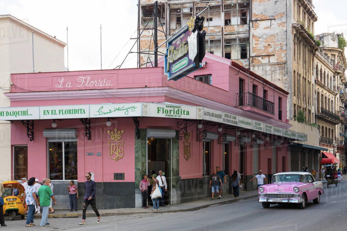Pink vintage American car outside Floridita bar, Havana, Cuba, West Indies, Caribbean, Central America Royalty-free stock photo