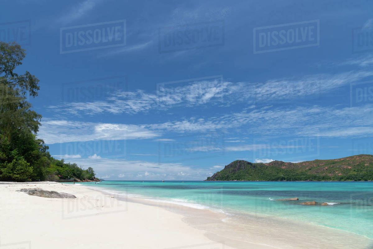 A view along Anse Boudin toward Curieuse Island from Praslin, Seychelles, Indian Ocean, Africa Royalty-free stock photo