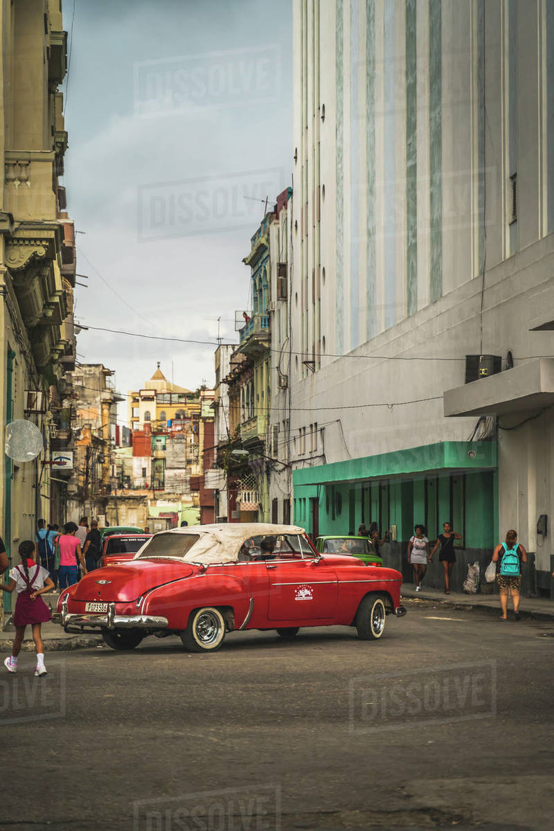 Red vintage car turning in streets of La Habana (Havana), Cuba, West Indies, Caribbean, Central America Royalty-free stock photo